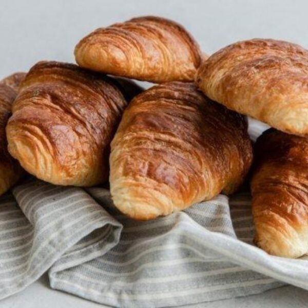 Bakers toms fresh croissants, baked daily